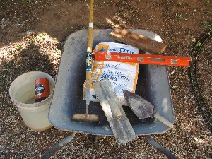 Tools used to mix and pour the concrete base
